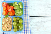 Tasty vegetarian food in plastic box on wooden table — Stock Photo