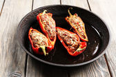 Delicious stuffed peppers in frying pan on table close-up — Stock Photo