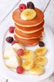Pancake with fruits and berries on plate on wooden table  — Stock Photo