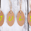 July tags on wooden background — Stock Photo #52791833