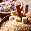 Brown sugar cubes and crystal sugar with spices — Stock Photo #52792655