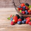 Ripe sweet different berries in metal basket — Stock Photo #52793417