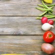 Summer frame with fresh organic vegetables on wooden background — Stock Photo #52793779