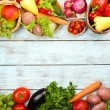 Summer frame with fresh organic vegetables and fruits on wooden background — Stock Photo #52793803