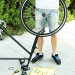 Man repairing his bike, close-up — Stock Photo #52795365