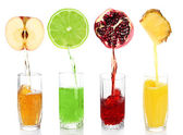 Juice pouring from fruits into glass, isolated on white — Stock Photo