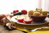 Young boiled potatoes with vegetables on table — Foto de Stock