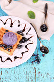 Tasty belgian waffles with ice cream on wooden table — Stock Photo