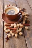 Brown sugar, spices and cup of coffee on wooden background — Foto Stock