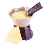 Fondue and slices of cheese — Stock Photo