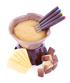 Fondue, rusk and slices of cheese — Stock Photo