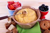 Fondue, tomatoes, olives, biscuits, slices of cheese — Stock Photo