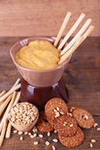 Fondue, spice, biscuits on wooden background — Stock Photo