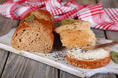 Baked bread and toast with fresh butter — Stockfoto