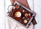 Candles on vintage tray with coffee grains — Stockfoto
