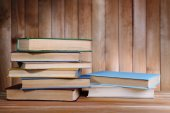 Books on wooden table on wooden wall background — Foto de Stock