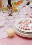Buffet table with dishware and candle — Stock Photo