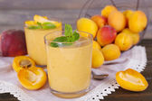 Apricot dessert in glasses on table close-up — Stock Photo
