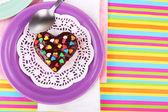 Delicious rainbow mini cakes on plates — Stock Photo