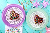 Delicious rainbow cakes on plates — Stock Photo