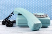 Retro turquoise telephone on wooden table — Stock Photo
