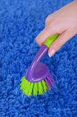 Cleaning carpet with brush close up — Stock Photo