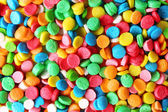 Colorful sugar sprinkles background — Stock Photo