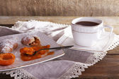 Still life with cup of tea and apricot jam on wooden table — Stock Photo