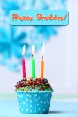 Delicious birthday cupcake on table on light background — Stock Photo
