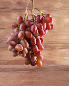 Bunch of grape on wooden background — Stok fotoğraf