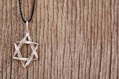 Star David pendant on wooden background — Stock Photo