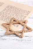 Star of David and page of Genesis book on wooden background — Foto de Stock