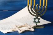 Menorah, star of David and page of Genesis book on wooden background — Foto de Stock