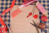Scrapbooking craft materials on bright background — Stock Photo