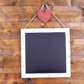 Square chalkboard on wooden background — Stock Photo