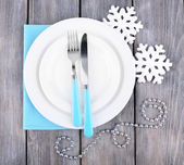 White plates, fork, knife and Christmas tree decoration on wooden background — Foto de Stock