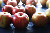 Juicy apples on wooden table, close-up — Stock Photo