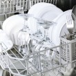Open dishwasher with clean utensils in it — Stock Photo #52843999