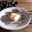 Tasty grape and cheese on plate, on wooden table — Stock Photo #52844271