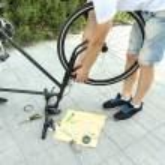 Man repairing his bike, close-up — Stock Photo #52845373