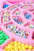 Multicoloured beading kit — Stock Photo