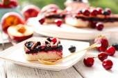 Sweet berry tart with berries on wooden table close-up — Foto Stock