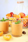 Apricot dessert in glasses on table on bright background — Stock Photo