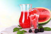 Watermelon cocktail in pitcher on wooden table on natural background — Foto Stock