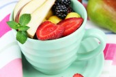 Fresh tasty fruit salad on table — Zdjęcie stockowe