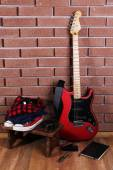 Guitar, trainers and clothes — Stock Photo