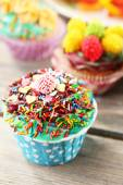 Delicious birthday cupcakes on table close-up — Stock Photo