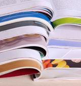 Magazines on wooden table — Stock Photo