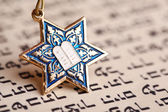Star David pendant on old paper page background — Stock Photo