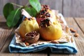 Baked apples on table on wooden background — Foto Stock